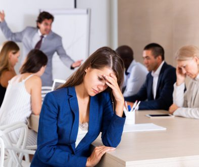 Upset young woman in meeting room